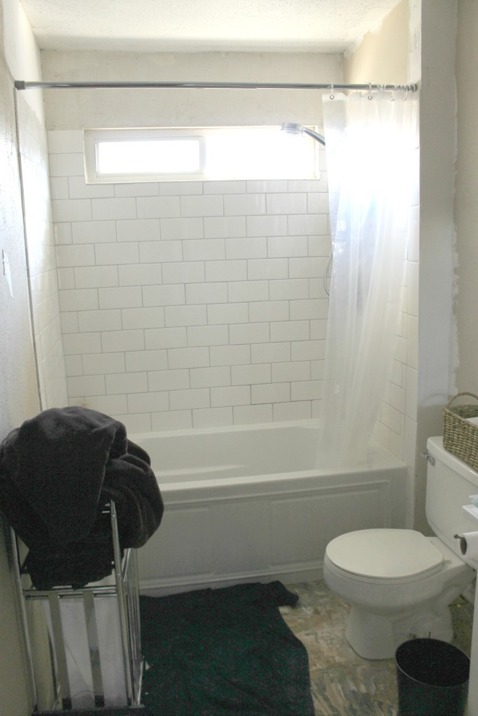 master bath reno with new white subway tile and grey grout