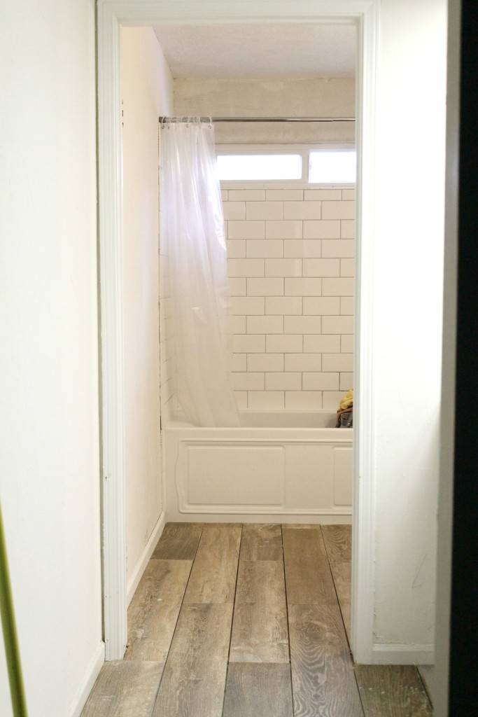 New woodlike tile installed in farmhouse master bath reno