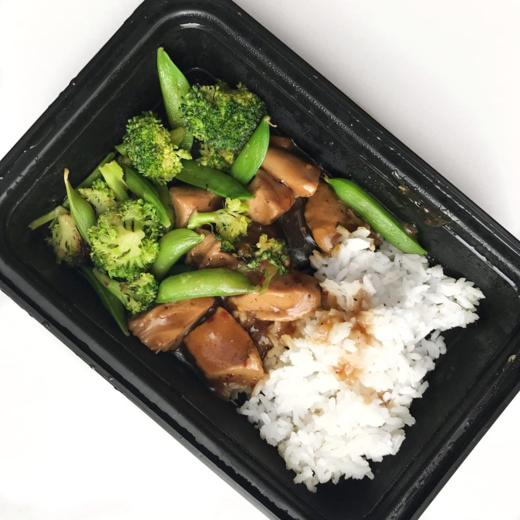 Weekly meal prep lunch of sesame chicken with broccoli, sugar snap peas and texmati rice