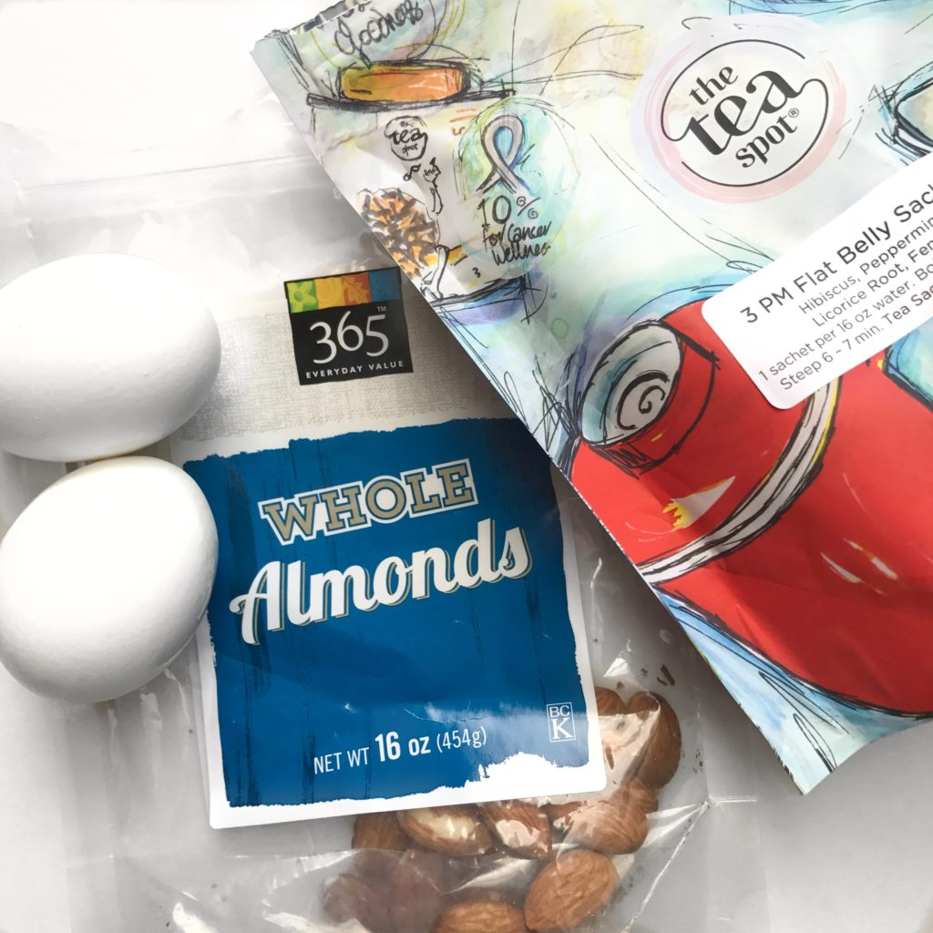 Weekly meal prep afternoon snack of raw unsalted almonds and hard boiled eggs with 3 pm flat belly tea