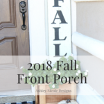 Beautifully decorated neutral fall front porch with white pumpkins, buffalo plaid layered rugs, and cozy farmhouse feel...